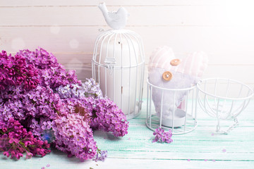Background with  lilac flowers and candle and heart