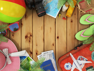 Travel concept. Sunbed, sunglasses, world map, beach shoes, sunscreen, passport, air tickets,camera, palms, beach ball, hat and old red suitcase for travel on the wood background.