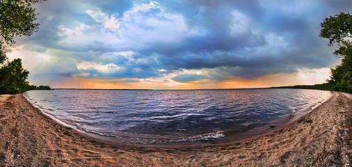 Sunset on the lake. Panorama