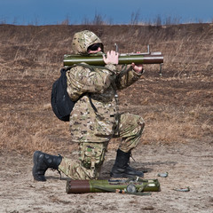 soldiers fired a grenade launcher