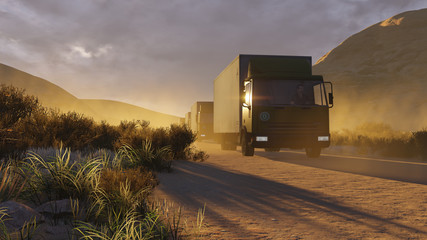 Military trucks on a desert road at evening time