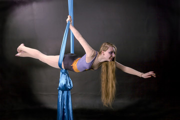 Young gymnast soars on silks