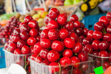 Display of cherries ready to eat at a market.