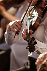 Hands of the girl playing the violin in the orchestra