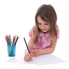 cute little girl drawing with colorful pencils isolated on white