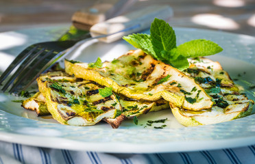 Zucchini summer salad with mint , grilled vegetables plate.