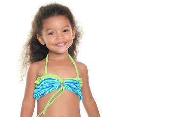 Cute small hispanic girl wearing a swimsuit