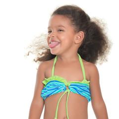 Cute small hispanic girl wearing a swimsuit