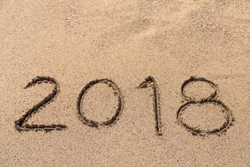 Year 2018 Written On Beach Sand