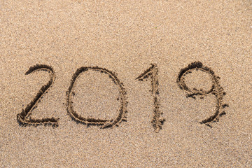 Year 2019 Written On Beach Sand