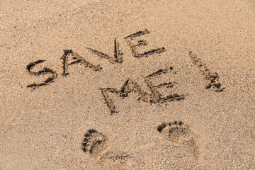 Save Me Sign Drawn On Beach Sand
