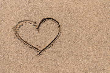 Heart Drawn On Ocean Beach Sand