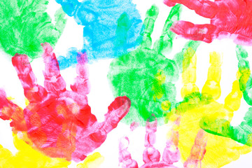 Multi colored painted hand prints on a white background.