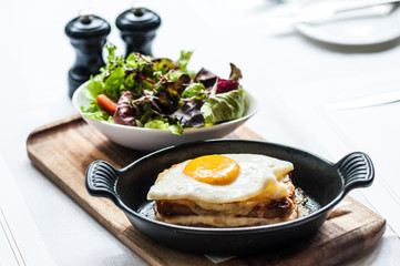 Breakfast menu with beautiful fried eggs and bread