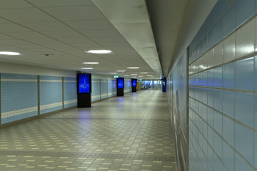 A long hallway to the entrance of an airport