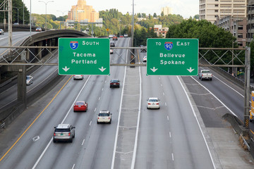 SEATTLE - JUNE 24, 2015 - View of the traffic on Interstate 5 (I5) looking south after rush hour. The directional signs for the cities of Portland, Spokane, Bellevue and Tacoma are displayed.