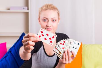 Woman holding magic card