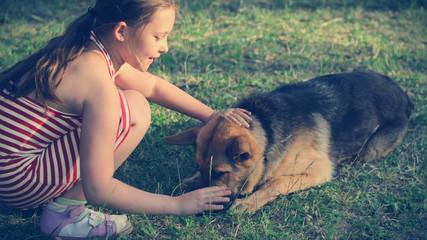 child and  German Shepherd