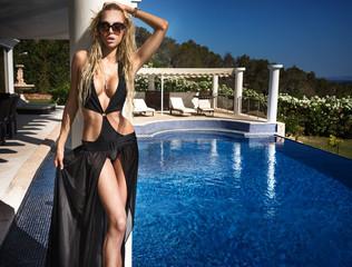 Girl on Vila poolside