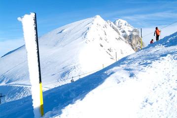 People sciing on mount Titlis over Engelberg
