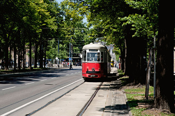 Tram car running along the line in city