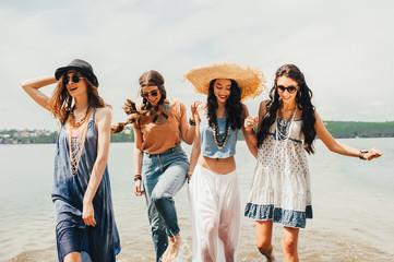 four beautiful girls on the beach