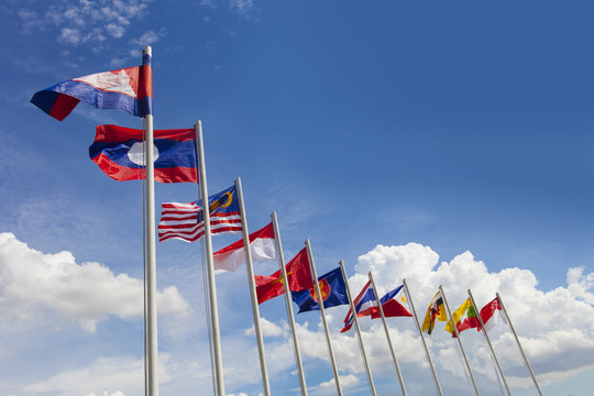 AEC flag, ASEAN flag, and the national flags of Southeast Asia countries on beautiful blue sky backgrond
