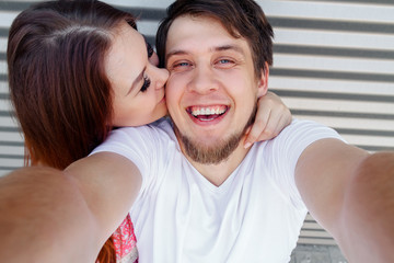 A young couple making selfie