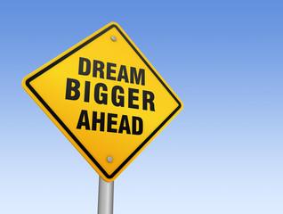 dream bigger ahead sign