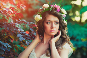 sweet beautiful young woman with a wreath of flowers on her head