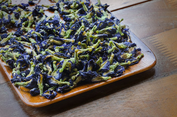 Dried flowers of blue herbal tea.