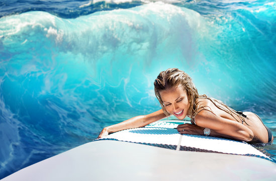 Girl rides a surfboard and laughs