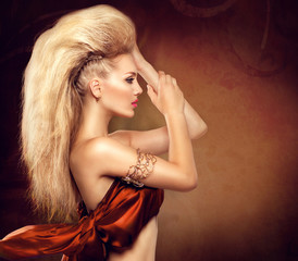 High fashion model girl with mohawk hairstyle