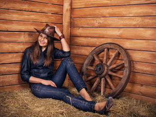 Woman cute seductive cowboy cowgirl on wooden background  in garden as symbol of beauty, rodeo, skill, seduction, sex, youth, adolescence, america, agriculture, ecology, farming, usa culture