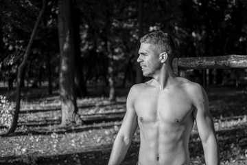 Man photographed in street workout session. Photo was taken in early morning, around 6am in city park Dudova forest. Black and white photo.
