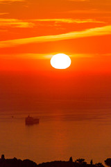 Sunrise on the sea with cargo stranded
