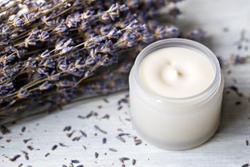 Cosmetic cream for face with lavender flowers