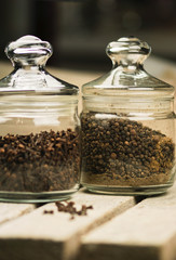 Black pepper, spices in jars