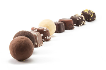 line of nine pieces of chocolate