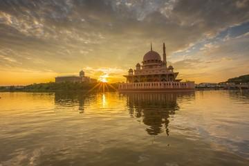 sunburst during sunrise at Putra Mosque, Putrajaya Malaysia