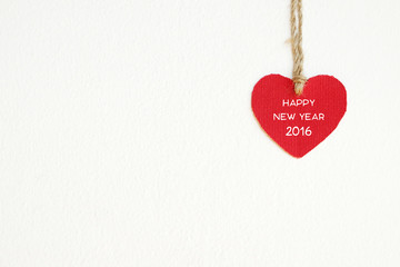 Red fabric heart with happy new year 2016 word