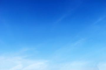 Fantastic soft white clouds against blue sky .