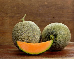 Fresh melon on wooden background.