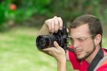 Man taking photos in park