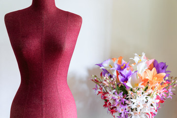 Clothing mannequin with flowers vase
