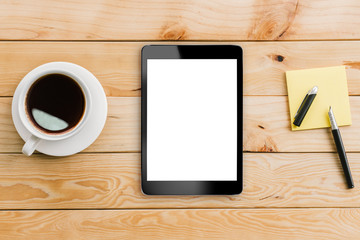 tablet white display and coffee on wood workspace