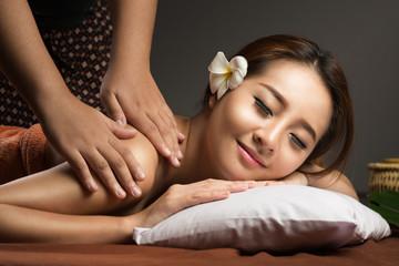 Asian woman having massage and spa salon Beauty treatment concept