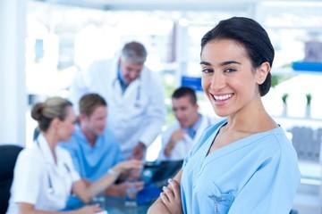 Beautiful smiling doctor looking at camera