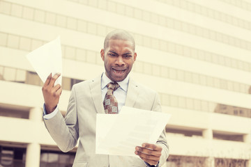stressed frustrated man holding looking at documents