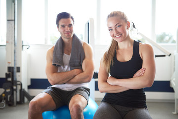 Young Fit Couple Inside the Gym Smiling at Camera